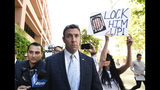 CORRECTS TO ATTRIBUTE THE REFERENCE TO HUNTER, NOT A JUSGE - FILE - In this July 1, 2019, file photo, U.S. Rep. Duncan Hunter leaves federal court after a motions hearing in San Diego. The California Republican plans to plead guilty on Tuesday, Dec. 3, 2019, to the misuse of campaign funds and has indicated he will leave Congress, he told KUSI television in San Diego in an interview that aired Monday. (AP Photo/Denis Poroy, File)