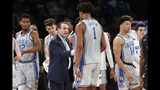 Duke coach Mike Krzyzewski talks to center Vernon Carey Jr. (1) during the second half of the team's NCAA college basketball game against California in the 2K Empire Classic, Thursday, Nov. 21, 2019, in New York. Duke won 87-52. (AP Photo/Kathy Willens)