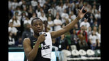 Michigan State guard Cassius Winston thanks the crowd for the support he and the Winston family have received after the death of his brother Zachary last week. Winston spoke after an NCAA college basketball game against Charleston Southern, Monday, Nov. 18, 2019, in East Lansing, Mich. (AP Photo/Carlos Osorio)