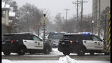 """Authorities respond to the scene of a shooting on Oakland Avenue South, Sunday, Dec. 1, 2019, in Minneapolis. Two boys were found shot late Sunday morning outside the residence, where two adults were found dead later in the day. The two boys were also later pronounced dead, in what police are calling a """"domestic related incident."""" (Kevin Martin/Star Tribune via AP)"""