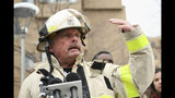 FILE - In this Wednesday, Nov. 27, 2019 file photo, Minneapolis Fire Department Chief John Fruetel speaks to the media in front of the building at 630 Cedar Avenue where an early morning fire killed multiple people in Minneapolis. Fire officials say the investigation into the fire is completed and that they haven't been able to determine the cause. Officials found the blaze was accidental, but they weren't able to pinpoint the exact cause. (Aaron Lavinsky/Star Tribune via AP, File)