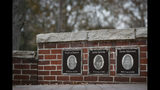 In this Thursday, Nov. 21, 2019 photo, the faces of the three Finneytown students killed in a stampede at The Who's Dec. 3, 1979 concert, are displayed as part of a memorial at the Finneytown High School secondary campus in Finneytown, Ohio. (AP Photo/John Minchillo)