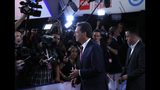 FILE - In this Tuesday, July 30, 2019, file photo, Montana Gov. Steve Bullock talks to reporters after the first of two Democratic presidential primary debates hosted by CNN in the Fox Theatre in Detroit. Bullock announced Monday, Dec. 2, 2019, that he is ending his Democratic presidential campaign. (AP Photo/Carlos Osorio, File)