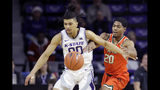 Kansas State's Mike McGuirl (0) and Florida A&M's Brendon Myles (20) chase the ball during the first half of an NCAA college basketball game Monday, Dec. 2, 2019, in Manhattan, Kan. (AP Photo/Charlie Riedel)