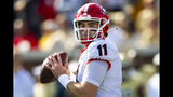 Georgia quarterback Jake Fromm looks to pass during the first half of an NCAA college football game against Georgia Tech, Saturday, Nov. 30, 2019 in Atlanta. (AP Photo/John Amis)