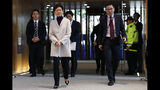 Hong Kong Chief Executive Carrie Lam, front left, arrives for a press conference at the Legislative Council in Hong Kong, Tuesday, Dec. 3, 2019. (AP Photo/Vincent Thian)