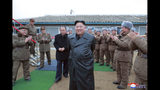 """FILE - This undated file photo provided on Friday, Nov. 29, 2019, by the North Korean government, shows North Korean leader Kim Jong Un, center, surrounded by a military unit, reacts to what it claims as a test firing of its """"super-large"""" multiple rocket launcher in North Korea. North Korea on Tuesday, Dec. 3, has repeated claims that the Trump administration is running out of time to salvage nuclear negotiations and says it's entirely up to the United States to choose what """"Christmas gift"""" it gets from the North.(Korean Central News Agency/Korea News Service via AP, File)"""