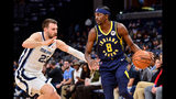 Indiana Pacers forward Justin Holiday (8) handles the ball against Memphis Grizzlies guard Marko Guduric (23) in the first half of an NBA basketball game Monday, Dec. 2, 2019, in Memphis, Tenn. (AP Photo/Brandon Dill)