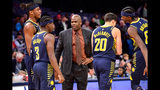 Indiana Pacers head coach Nate McMillan, center, talks with center Myles Turner (33), guard Aaron Holiday (3), and forwards Doug McDermott (20) and Justin Holiday (8) in the second half of an NBA basketball game against the Memphis Grizzlies, Monday, Dec. 2, 2019, in Memphis, Tenn. (AP Photo/Brandon Dill)