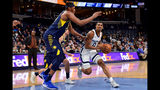 Memphis Grizzlies guard De'Anthony Melton (0) handles the ball against Indiana Pacers center Myles Turner in the second half of an NBA basketball game Monday, Dec. 2, 2019, in Memphis, Tenn. (AP Photo/Brandon Dill)