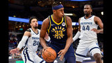 Indiana Pacers center Myles Turner (33) handles the ball against Memphis Grizzlies forward Solomon Hill (44) and guard Dillon Brooks (24)in the first half of an NBA basketball game Monday, Dec. 2, 2019, in Memphis, Tenn. (AP Photo/Brandon Dill)