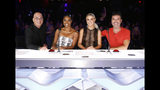 """This image released by NBC shows celebrity judges, from left, Howie Mandel, Gabrielle Union, Julianne Hough, Simon Cowell on the set of """"America's Got Talent,"""" in Los Angeles. Union is thanking supporters for defending her amid reports she was fired from """"America's Got Talent"""" after complaining about racism and other on-set issues. Without directly addressing her status with NBC's talent show, the actress tweeted that the backing helped overcome feeling of being lost and alone. (Trae Patton/NBC via AP)"""