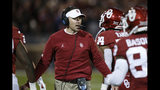 Oklahoma head coach Lincoln Riley greets players as they return to the sideline after scoring in the first half of an NCAA college football game against TCU in Norman, Okla., Saturday, Nov. 23, 2019. (AP Photo/Sue Ogrocki)