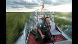 In this Tuesday, Oct. 22, 2019 photo, tour guide Gianni Magrini pilots an airboat across a sawgrass marsh in Everglades National Park. Margrini, whose livelihood depends on tourism, has been guiding in the park for 25 years. (AP Photo/Robert F. Bukaty)