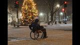 Stephen Willard pushes his wheelchair through the snow as he heads to his apartment in Keene, N.H., Sunday, Dec. 1, 2019. (Kristopher Radder/The Brattleboro Reformer via AP)