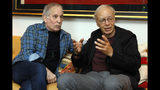 "This Nov. 8, 2019 photo shows singer-songwriter, Paul Simon, left, and author-philosopher Peter Singer during an interview in New York to promote the new edition of Singer's book ""The Life You Can Save."" (AP Photo/Richard Drew)"