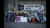 Tributes are placed by the southern end of London Bridge in London, Monday, Dec. 2, 2019. London Bridge reopened to cars and pedestrians Monday, three days after a man previously convicted of terrorism offenses stabbed two people to death and injured three others before being shot dead by police. (AP Photo/Matt Dunham)