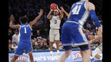 Georgetown guard James Akinjo (3) shoots during the second half as Duke center Vernon Carey Jr. (1) defends during the second half of an NCAA college basketball game in the 2K Empire Classic, Friday, Nov. 22, 2019 in New York. Duke won 81-73. (AP Photo/Kathy Willens)