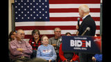 Audience members listen to Democratic presidential candidate former U.S. Vice President Joe Biden speak during a bus tour stop at Water's Edge Nature Center, Monday, Dec. 2, 2019, in Algona, Iowa. (AP Photo/Charlie Neibergall)