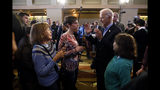 Democratic presidential candidate former Vice President Joe Biden talks with audience members during a bus tour stop, Tuesday, Dec. 3, 2019, in Mason City, Iowa. (AP Photo/Charlie Neibergall)