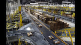 FILE- In this Aug. 3, 2017, file photo, packages ride on a conveyor system at an Amazon fulfillment center in Baltimore. Amazon, Walmart and others are promising to deliver more of their goods in a day and this holiday season will be the first real test of whether they can make that happen. (AP Photo/Patrick Semansky, File)