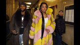 "Rapper Remy Ma, whose real name is Reminisce Smith, leaves Manhattan criminal court, with husband Shamele Mackie, whose stage name is Papoose, in New York, Monday, Dec. 2, 2019. She's accused of punching her ""Love & Hip Hop New York"" co-star Brittney Taylor in the face during an April 16 concert at Irving Plaza, in Manhattan. (AP Photo/Richard Drew)"