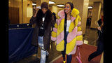 "Rapper Remy Ma, whose real name is Reminisce Smith, leaves Manhattan criminal court, with her husband Shamele Mackie, whose stage name is Papoose, in New York, Monday, Dec. 2, 2019. She's accused of punching her ""Love & Hip Hop New York"" co-star Brittney Taylor in the face during an April 16 concert at Irving Plaza, in Manhattan. (AP Photo/Richard Drew)"
