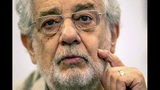 """FILE - In this July 12, 2019, file photo, opera singer Placido Domingo speaks during a news conference about his upcoming show """"Giovanna d'Arco"""" in Madrid, Spain. Two opera singers who have accused Domingo of sexual misconduct reacted angrily to his claims in recent interviews that he never behaved improperly and always acted gallantly and like a gentleman with women. Angela Turner Wilson and Patricia Wulf issued a statement Tuesday, Dec. 3, 2019, saying they found Domingo's comments and his """"continued failure to take responsibility for wrongdoing"""" to be disappointing and deeply disturbing. (AP Photo/Bernat Armangue, File)"""