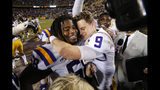 LSU quarterback Joe Burrow (9) hugs guard Damien Lewis after the team's NCAA college football game against Texas A&M in Baton Rouge, La., Saturday, Nov. 30, 2019. LSU won 50-7. (AP Photo/Gerald Herbert)