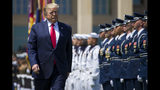 FILE - In this July 25, 2019, file photo, President Donald Trump reviews the troops during a full honors welcoming ceremony for Secretary of Defense Mark Esper at the Pentagon in Washington. If there was one day that crystallized all the forces that led to the impeachment investigation of President Donald Trump, it was July 25. That was the day of his phone call with Ukraine's new leader, pressing him for a political favor. (AP Photo/Alex Brandon, File)