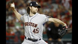 FILE - In this Oct. 27, 2019, file photo, Houston Astros starting pitcher Gerrit Cole throws against the Washington Nationals during the first inning of Game 5 of the baseball World Series in Washington. Gerrit Cole, the top pitcher on the free-agent market, was to meet with New York Yankees officials in California on Tuesday, Dec. 3, 2019. General manager Brian Cashman, manager Aaron Boone and new Yankees pitching coach Matt Blake made the trip to speak with the 29-year-old right-hander, a person familiar with the planning said. The person spoke to The Associated Press on condition of anonymity because the meeting was not announced.(AP Photo/Patrick Semansky, File)